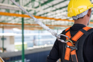 construction worker wearing safety harness, if needing to file a workers comp claim contact the leading construction accident attorney serving Newport News.