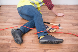 a photo of a construction worker injured after tripping, our law firm can assist you with construction accident issues