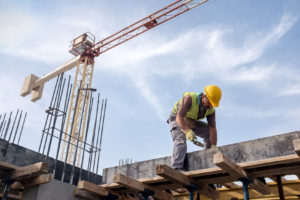 A photo of a worker on a construction site representing how our law firm can assist you with construction accident claims