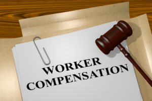Newport News Workers Compensation Attorney representing case with paperwork and gavel