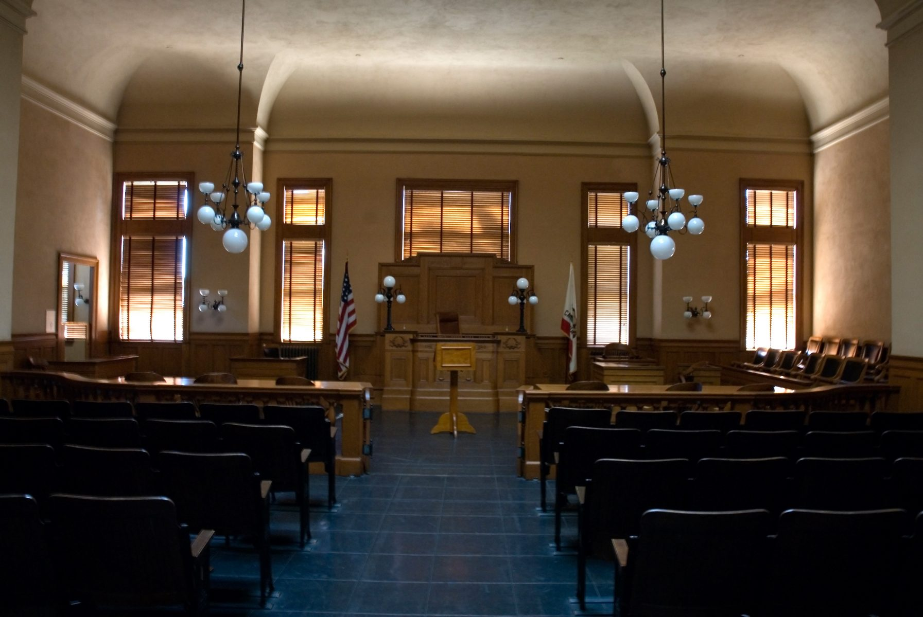 A photo of a courtroom showing how you should consult with a Virginia workers' compensation lawyer.